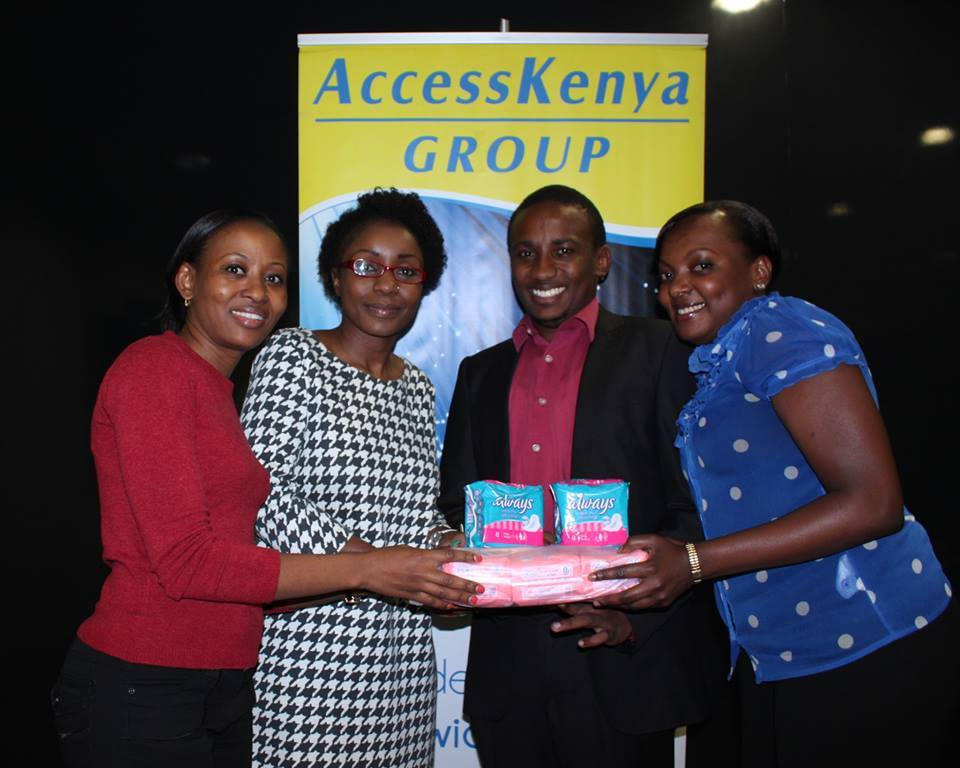 Recieving sanitary towels from Access Kenya on behalf of a million reasons