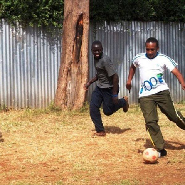 Playing football with mentees at vision africa