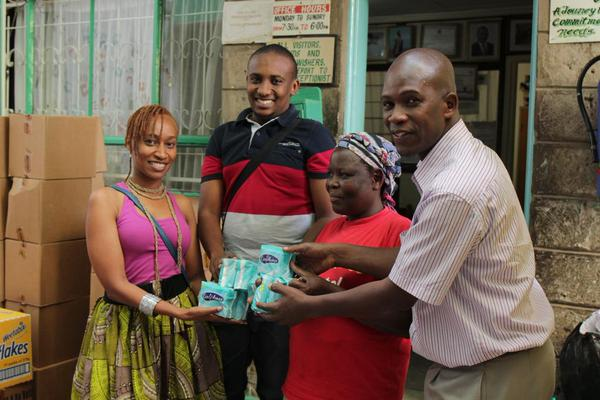 Presenting donation at Mama Fatuma Children's Home with Wini Nkinda