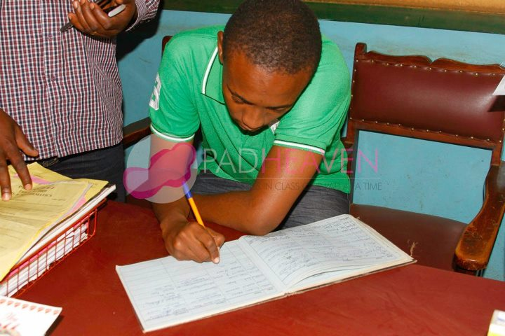 Signing the visitors books at Kamenu primary school where sanitary towels were donated