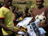 Delivering football kit to Jikaze IDP youth